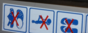 sign from Barcelona Airport: no crocs, no segways, no flipflops