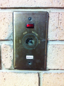 "Obscure old panel with a button marked ""biddle"" on i"