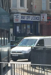 "Sign cut off so that it seems to read ""way off licence"""